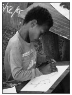 A Papua New Guinean child attending school in his own language