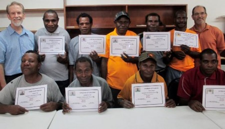 Norm Weatherhead and Jim Bliffen with graduates of PBT-PNG's Computer/Paratext 2 Workshop